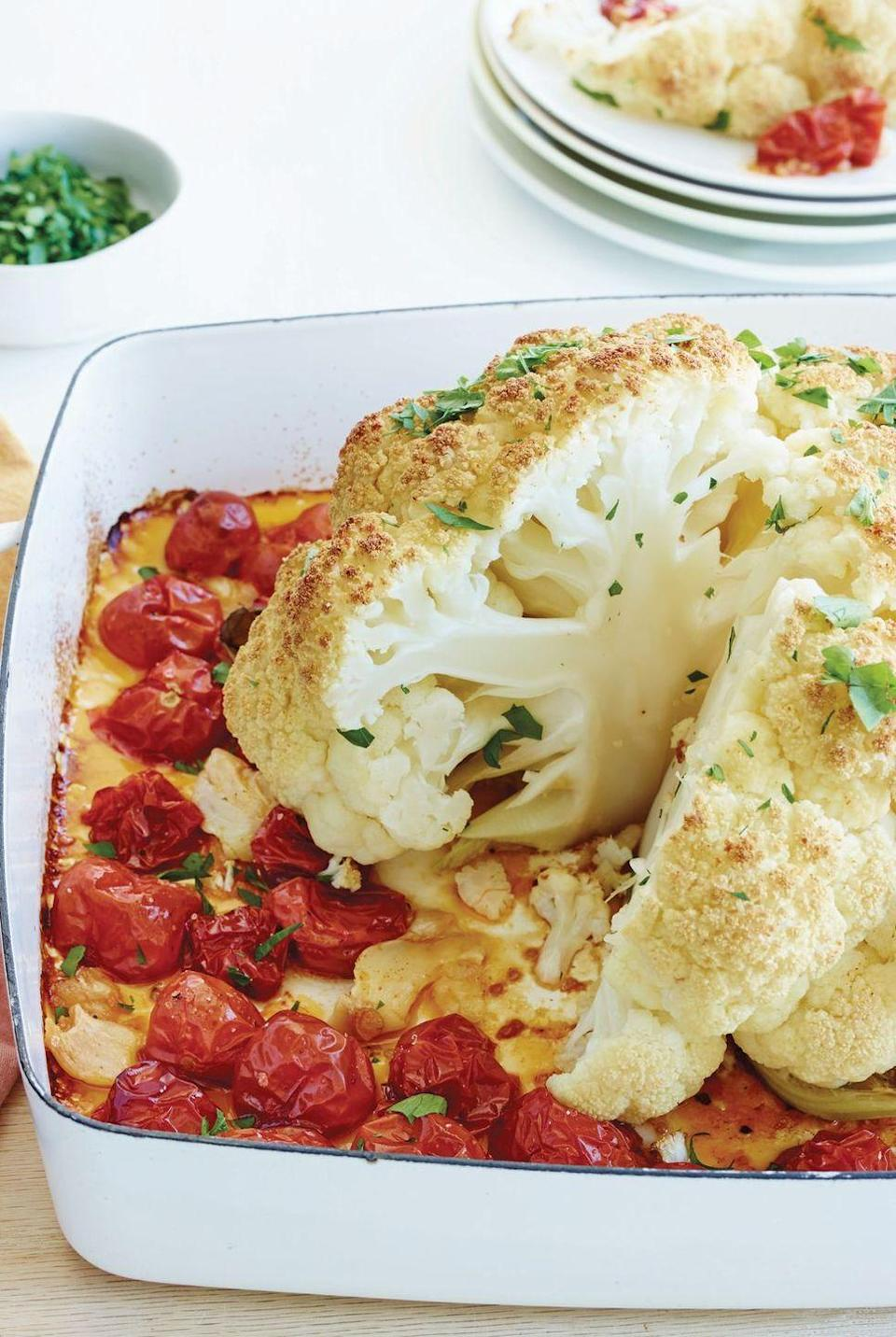 """<p>I love the drama of this <a href=""""https://www.delish.com/uk/cooking/recipes/a29695647/thanksgiving-cauliflower-recipe/"""" rel=""""nofollow noopener"""" target=""""_blank"""" data-ylk=""""slk:whole roasted cauliflower"""" class=""""link rapid-noclick-resp"""">whole roasted cauliflower</a>—the presentation, the slicing—which always brings down the house.</p><p>Get the <a href=""""https://www.delish.com/uk/cooking/recipes/a34639851/whole-roasted-cauliflower-tomatoes-and-garlic-recipe/"""" rel=""""nofollow noopener"""" target=""""_blank"""" data-ylk=""""slk:Whole Roasted Cauliflower, Tomatoes and Garlic"""" class=""""link rapid-noclick-resp"""">Whole Roasted Cauliflower, Tomatoes and Garlic</a> recipe.</p>"""