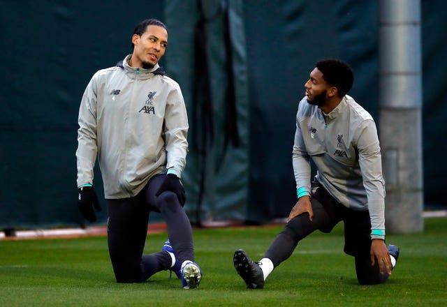 Liverpool's Virgil Van Dijk and Joe Gomez warm-up during a training session