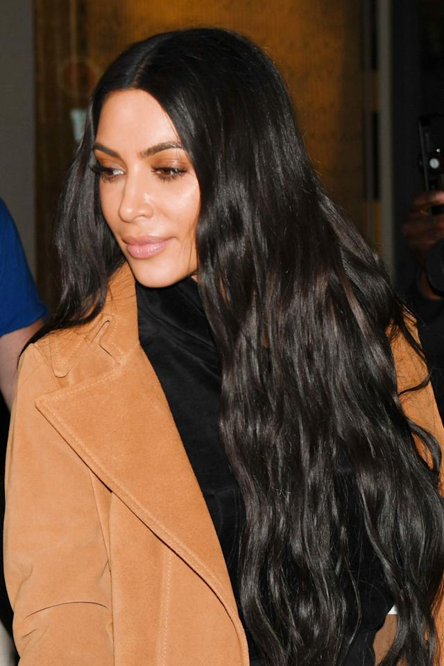 <p>Since the Paris incident, Kim K almost always had extra-long, straight hair. This high-shine wave was a rare occurrence. </p>