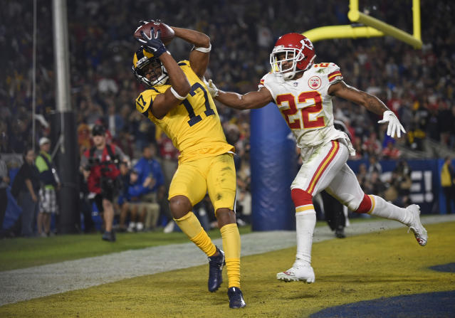 "<a class=""link rapid-noclick-resp"" href=""/nfl/teams/la-rams/"" data-ylk=""slk:Los Angeles Rams"">Los Angeles Rams</a> wide receiver Robert Woods (17) catches a pass for a touchdown ahead of <a class=""link rapid-noclick-resp"" href=""/nfl/teams/kansas-city/"" data-ylk=""slk:Kansas City Chiefs"">Kansas City Chiefs</a> defensive back Orlando Scandrick (22) in the 2018 thriller. (AP Photo/Kelvin Kuo)"