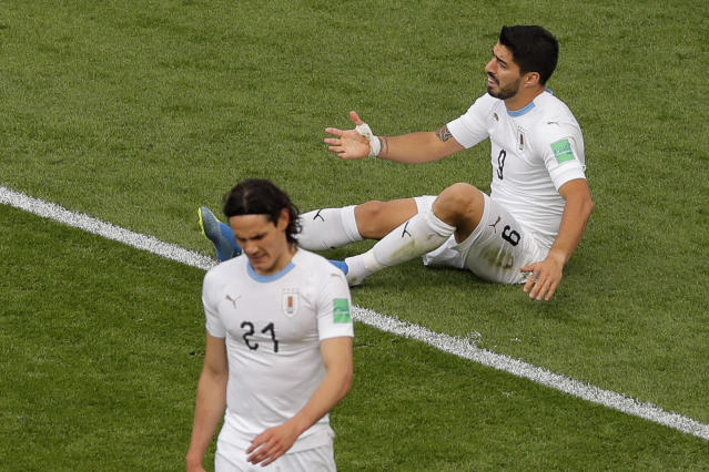 Uruguay's Luis Suarez, top, reacts after failing to score next to Uruguay's Edinson Cavani during the group A match between Egypt and Uruguay at the 2018 soccer World Cup in the Yekaterinburg Arena in Yekaterinburg, Russia, Friday, June 15, 2018. (AP Photo/Vadim Ghirda)