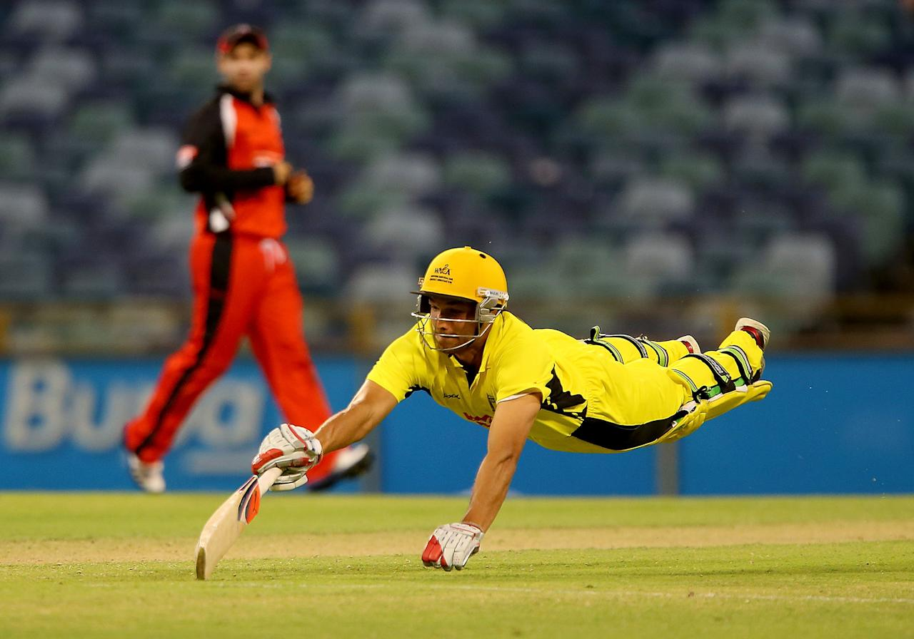 PERTH, AUSTRALIA - NOVEMBER 17:  Nathan Coulter-Nile of the Warriors dives to make his crease during the Ryobi Cup One Day match between the Western Australia Warriors and the South Australian Redbacks at WACA on November 17, 2012 in Perth, Australia.  (Photo by Paul Kane/Getty Images)