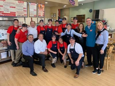 Jersey Mike's Founder & CEO Peter Cancro (kneeling, 2nd from left) celebrated the company's Annual Day of Giving in 2019 at the Northridge, Calif. restaurant.
