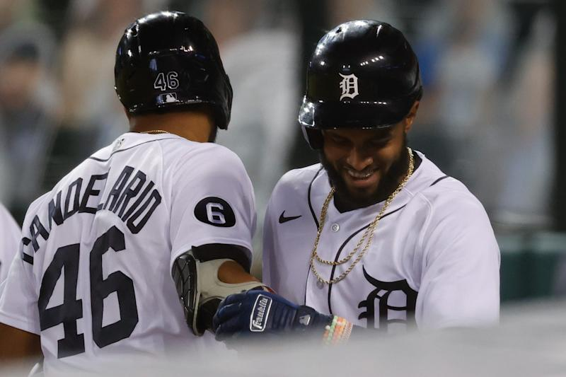 Sep 15, 2020; Detroit, Michigan, USA; Detroit Tigers shortstop Willi Castro (49) celebrates with third baseman Jeimer Candelario (46) after hitting a home run in the sixth inning against the Kansas City Royals at Comerica Park.