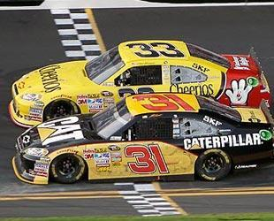 Jeff Burton nosed out teammate Clint Bowyer by .005 seconds to win the second Duel 150