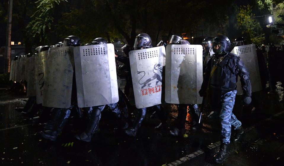 Riot police move to disperse protesters during a rally against the results of a parliamentary vote in Bishkek on October 5, 2020. (Photo by VYACHESLAV OSELEDKO / AFP) (Photo by VYACHESLAV OSELEDKO/AFP via Getty Images)