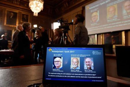 The names of Rainer Weiss Barry C. Barish Kip S. Thorne are displayed on the screen during the announcement of the winners of the Nobel Prize in Physics 2017 in Stockholm
