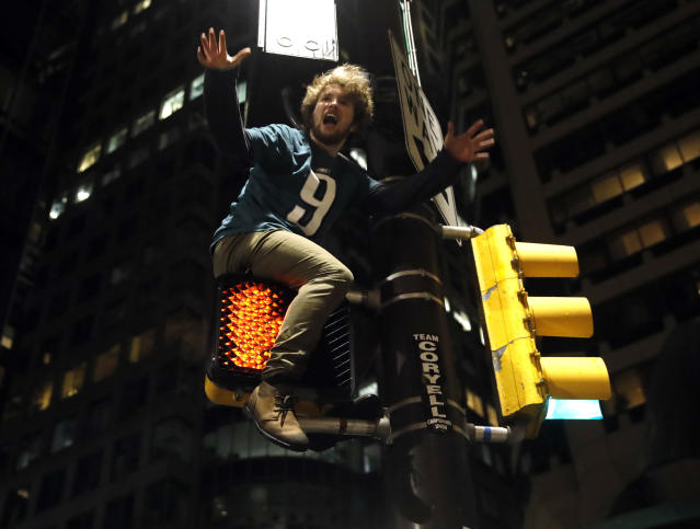 <p>A Philadelphia Eagles fan celebrates the team's victory in the NFL Super Bowl 52 between the Philadelphia Eagles and the New England Patriots, Sunday, Feb. 4, 2018, in downtown Philadelphia. (AP Photo/Matt Rourke) </p>