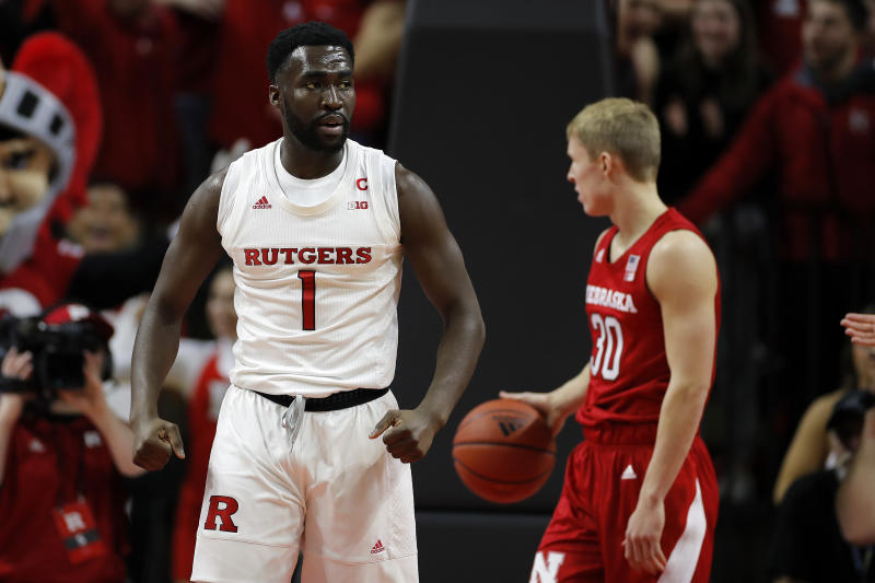 Rutgers forward Akwasi Yeboah (1) reacts after making a basket in front of Nebraska guard Charlie Easley (30) during the first half of an NCAA college basketball game Saturday, Jan. 25, 2020, in Piscataway, N.J. (AP Photo/Adam Hunger)
