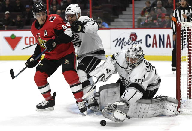 Los Angeles Kings goaltender Jack Campbell (36) reaches for the puck in front of defenseman Sean Walker (26) and Ottawa Senators center Jean-Gabriel Pageau (44) during second-period NHL hockey game action in Ottawa, Ontario, Thursday, Nov. 7, 2019. (Justin Tang/The Canadian Press via AP)
