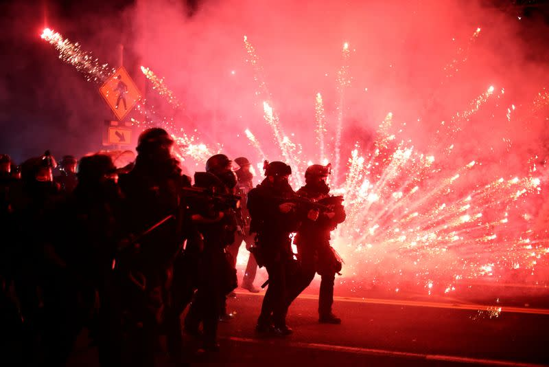 Portland police make over 50 arrests, use tear gas as protesters throw fire bombs