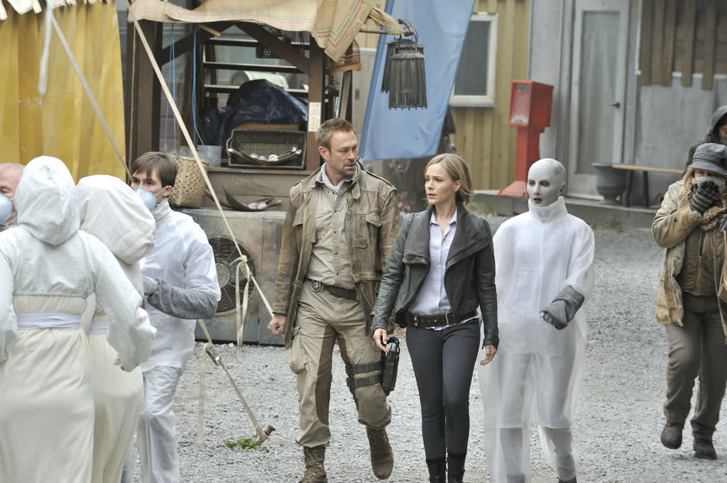 "Grant Bowler as Chief Lawkeeper Joshua Nolan, Julie Benz as Mayor Amanda Rosewater, and Trenna Keating as Doc Yewll in the ""Defiance"" episode, ""If I Ever Leave This World Alive."""