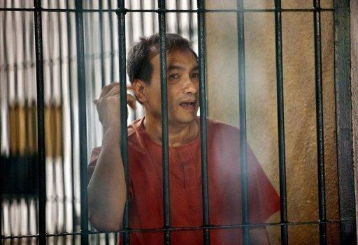 Thai-born US citizen Joe Wichai Commart Gordon is seen at the Criminal Court in Bangkok in December 2011. Gordon, jailed for insulting the king, has been pardoned by the monarch, in a move welcomed by the United States