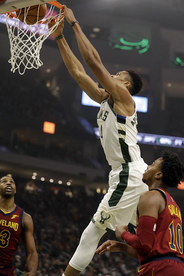 Milwaukee Bucks' Giannis Antetokounmpo, top, dunks against the Cleveland Cavaliers during the first half of an NBA basketball game Monday, Oct. 28, 2019, in Milwaukee. (AP Photo/Jeffrey Phelps)