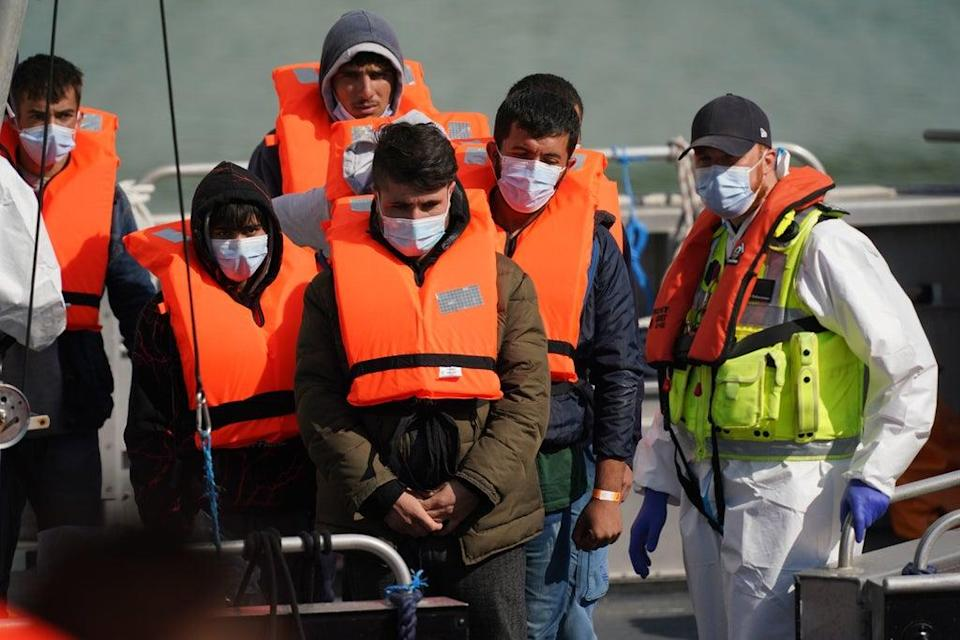 A group of people thought to be migrants are brought into Dover, Kent, by a Border Force patrol boat (PA) (PA Wire)