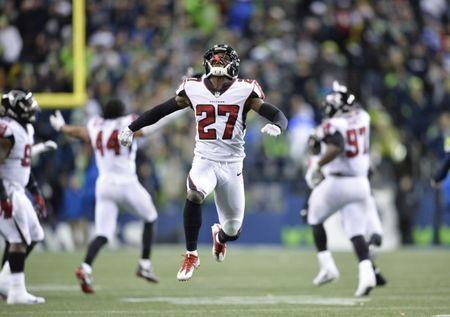 Nov 20, 2017; Seattle, WA, USA; Atlanta Falcons free safety Damontae Kazee (27) celebrates after defeating the Seattle Seahawks at CenturyLink Field. Atlanta defeated Seattle 34-31. Steven Bisig-USA TODAY Sports
