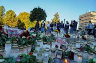 Residents laid candles and flowers after the deadly attack in the small town (AFP/Terje Bendiksby)