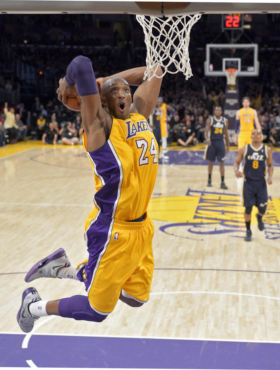 FILE - In this Jan. 25, 2013 file photo, Los Angeles Lakers guard Kobe Bryant goes up for a dunk during the first half of an NBA basketball game against the Utah Jazz, in Los Angeles. The Lakers have signed Bryant to a 2-year contract extension. General manager Mitch Kupchak made the announcement Monday, Nov. 25, 2013, ending speculation that Bryant could end up with another team after this season. (AP Photo/Mark J. Terrill, File)