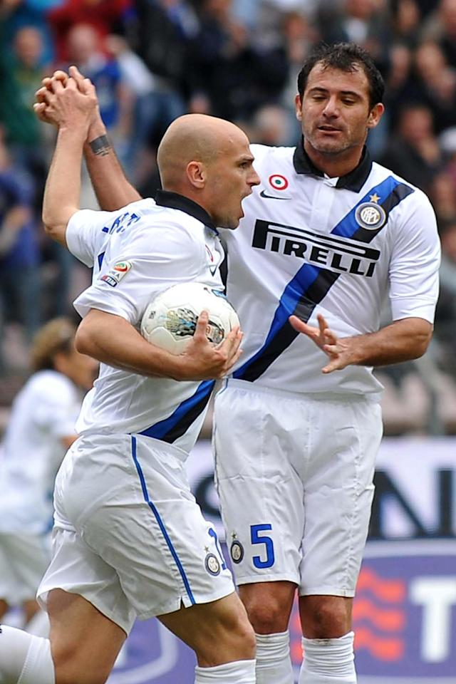 Inter Milan's Esteban Cambiasso (L)celebrates scoring with teammate Dejan Stankovic during the Italian Serie A football match between Cagliari and Inter Milan on April 7, 2012 at Nereo Rocco Stadium in Trieste. AFP PHOTO / Anteprima (Photo credit should read Anteprima/AFP/Getty Images)