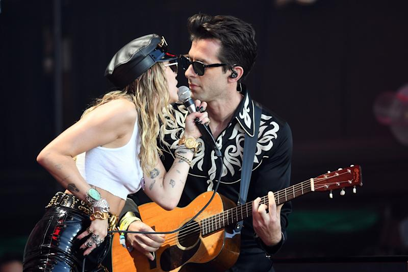 US singer Miley Cyrus (L) performs with British musician Mark Ronson at the Glastonbury Festival of Music and Performing Arts on Worthy Farm near the village of Pilton in Somerset, South West England, on June 30, 2019. (Photo by Oli SCARFF / AFP) (Photo credit should read OLI SCARFF/AFP/Getty Images)