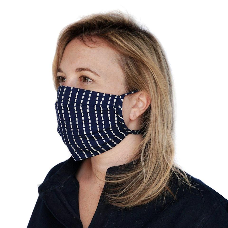"""This accordion-folded mask is made of two layers of 100% woven cotton and has an embedded copper nose band that helps reduce eyewear fogging. A built-in pocket lets you add your own filter.<br /><a href=""""https://rendallco.com/products/sentry?variant=33220960977036"""" target=""""_blank"""" rel=""""noopener noreferrer""""><strong><br />Get the Sentry face mask for $19</strong></a>"""