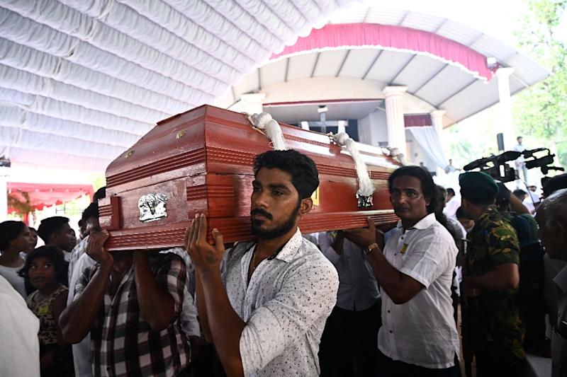 A steady stream of coffins were brought into St Sebastian's Church in Negombo as relatives looked on (AFP Photo/Jewel SAMAD)