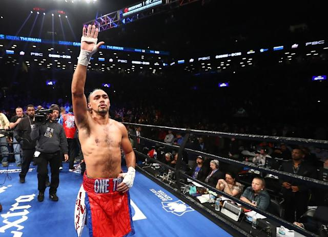 Keith Thurman celebrates his split decision win against Danny Garcia after their WBA/WBC Welterweight unification Championship bout at the Barclays Center in Brooklyn, New York on March 4, 2017 (AFP Photo/AL BELLO)