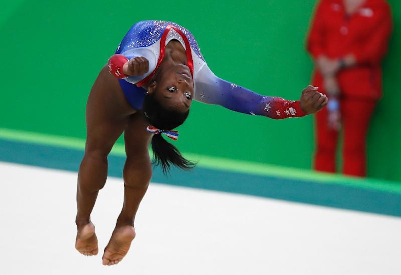 Simone Biles posted a 15.966 to win the floor exercise. (AFP)