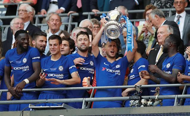 Soccer Football - FA Cup Final - Chelsea vs Manchester United - Wembley Stadium, London, Britain - May 19, 2018 Chelsea's Eden Hazard lifts the trophy as they celebrate winning the FA Cup REUTERS/David Klein