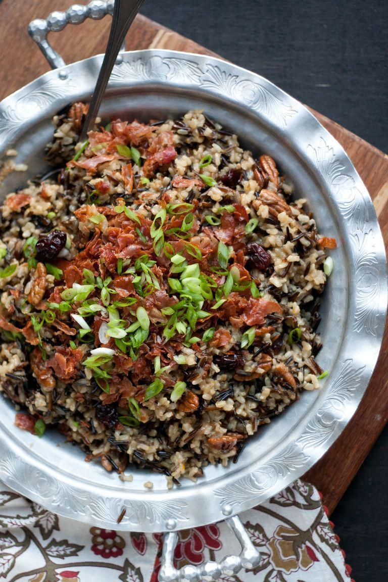 "<p>Try this recipe if you've got anyone at your Thanksgiving table who's gluten-free, or just want to try a rice-based stuffing versus a bread-based stuffing.</p><p><a href=""https://www.thepioneerwoman.com/food-cooking/recipes/a80398/thanksgiving-dinner-gluten-free-wild-rice-stuffing/"" rel=""nofollow noopener"" target=""_blank"" data-ylk=""slk:Get the recipe."" class=""link rapid-noclick-resp""><strong>Get the recipe.</strong></a></p><p><strong><a class=""link rapid-noclick-resp"" href=""https://go.redirectingat.com?id=74968X1596630&url=https%3A%2F%2Fwww.walmart.com%2Fbrowse%2Fhome%2Fthe-pioneer-woman-pots-pans%2F4044_623679_8140341_9944424&sref=https%3A%2F%2Fwww.thepioneerwoman.com%2Ffood-cooking%2Fmeals-menus%2Fg33251890%2Fbest-thanksgiving-sides%2F"" rel=""nofollow noopener"" target=""_blank"" data-ylk=""slk:SHOP POTS AND PANS"">SHOP POTS AND PANS</a><br></strong></p>"