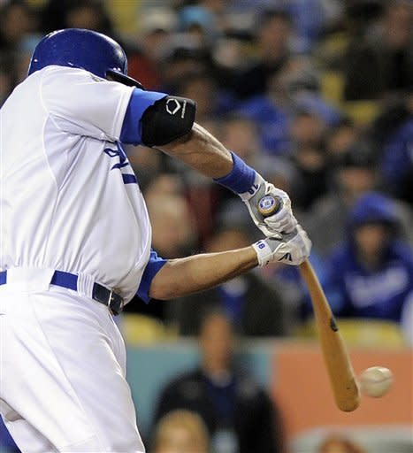 Los Angeles Dodgers' Andre Ethier swings on an RBI base hit during the sixth inning of a baseball game against the Pittsburgh Pirates, Wednesday, April 11, 2012, in Los Angeles. (AP Photo/Mark J. Terrill)