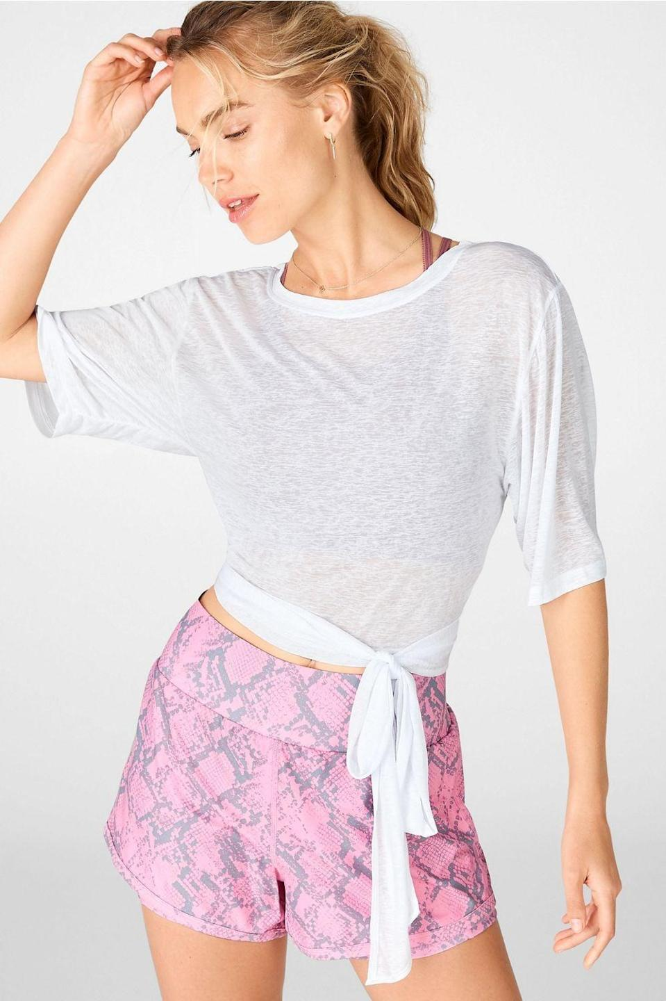 "<p>This <a href=""https://www.popsugar.com/buy/Fabletics-Ryan-SS-Tie-Up-Tee-586512?p_name=Fabletics%20Ryan%20S%2FS%20Tie%20Up%20Tee&retailer=fabletics.com&pid=586512&price=20&evar1=fit%3Auk&evar9=46472938&evar98=https%3A%2F%2Fwww.popsugar.com%2Ffitness%2Fphoto-gallery%2F46472938%2Fimage%2F47590620%2FFabletics-Ryan-SS-Tie-Up-Tee&list1=shopping%2Cworkout%20clothes%2Cfitness%20gear%2Cproducts%20under%20%2450%2C50%20under%20%2450%2Cfitness%20shopping%2Caffordable%20shopping&prop13=api&pdata=1"" class=""link rapid-noclick-resp"" rel=""nofollow noopener"" target=""_blank"" data-ylk=""slk:Fabletics Ryan S/S Tie Up Tee"">Fabletics Ryan S/S Tie Up Tee</a> ($20, originally $50) is such a cute take on a basic white tee.</p>"