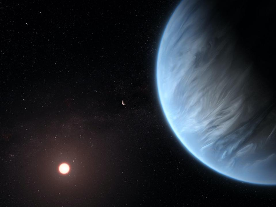 An artist's impression shows the planet K2-18b, its host star and an accompanying planet in this system. K2-18b is now the only super-Earth exoplanet known to host both water and temperatures that could support life. UCL researchers used archive data from 2016 and 2017 captured by the NASA/ESA Hubble Space Telescope and developed open-source algorithms to analyze the starlight filtered through K2-18b's atmosphere. The results revealed the molecular signature of water vapor, also indicating the presence of hydrogen and helium in the planet's atmosphere.