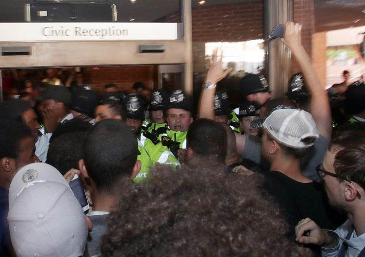 Protesters try to enter Kensington town hall in west London, the headquarters of the Royal Borough of Kensington and Chelsea, demanding answers over the Grenfell Tower disaster.