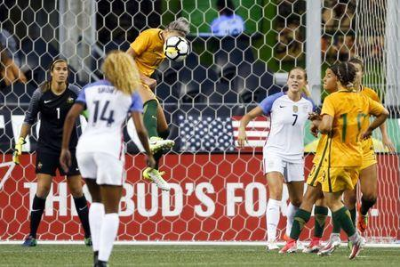 Jul 27, 2017; Seattle, WA, USA; Australia defender Alanna Kennedy heads away a shot attempt by USA during the second half at Century Link Field. Mandatory Credit: Joe Nicholson-USA TODAY Sports