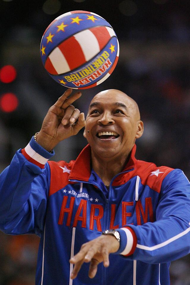 Curly Neal, of the Harlem Globetrotters, performs during a timeout in the second quarter in the game between the Indiana Pacers and the Phoenix Suns of their NBA basketball game, Wednesday, Jan. 9, 2008, in Phoenix. (AP Photo/Ross D. Franklin)