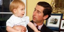 <p>Prince Charles holds a one-year-old Prince Harry in Kensington Palace. <br></p>
