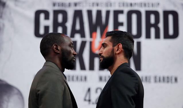 Terence Crawford and Amir Khan go head to head during a news conference. (Reuters)