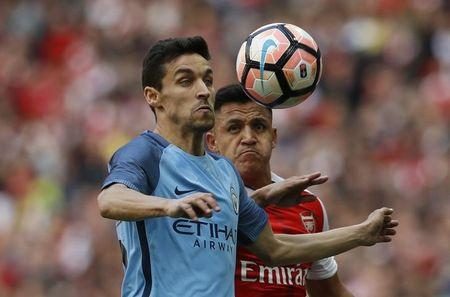 Manchester City's Jesus Navas in action with Arsenal's Alexis Sanchez
