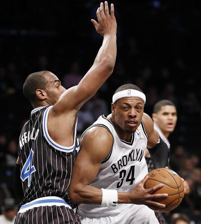 Brooklyn Nets forward Paul Pierce (34) drives past Orlando Magic guard Arron Afflalo (4) in the first half of their NBA basketball game at the Barclays Center, Tuesday, Jan. 21, 2014 in New York. (AP Photo/Kathy Willens)