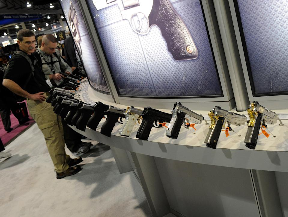 LAS VEGAS, NV - JANUARY 18:  Handguns are displayed at the Taurus International Firearms booth at the National Shooting Sports Foundation's 33rd annual Shooting, Hunting and Outdoor Trade (SHOT) Show at the Sands Expo and Convention Center January 18, 2011 in Las Vegas, Nevada. The shooting rampage in Tucson, Arizona on January 8 that killed six people and injured 13 people, including U.S. Rep. Gabrielle Giffords (D-AZ), has sparked debate about gun laws in the media and Congress.  (Photo by Ethan Miller/Getty Images)