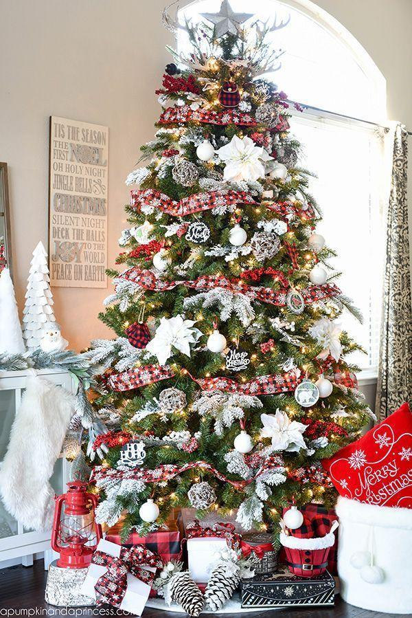 """<p>To balance out the all-white display, layer red and black plaid ribbon around the entire tree. </p><p><em><a href=""""https://apumpkinandaprincess.com/buffalo-check-christmas-tree"""" rel=""""nofollow noopener"""" target=""""_blank"""" data-ylk=""""slk:Get the tutorial at A Pumpkin & a Princess »"""" class=""""link rapid-noclick-resp"""">Get the tutorial at A Pumpkin & a Princess »</a></em></p>"""
