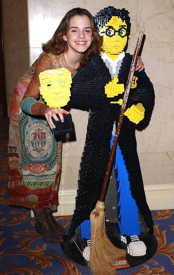 <p>On Nov. 30, 2003, Watson receives the Lego/BAFTA Kids Vote Award for her performance in <em>Harry Potter and the Chamber of Secrets</em>. (Photo: Steve Finn/Getty Images) </p>