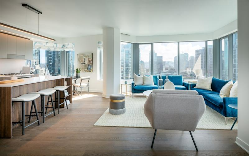 A view of a model unit inside the building, showing the open floor layout and ample natural lighting.