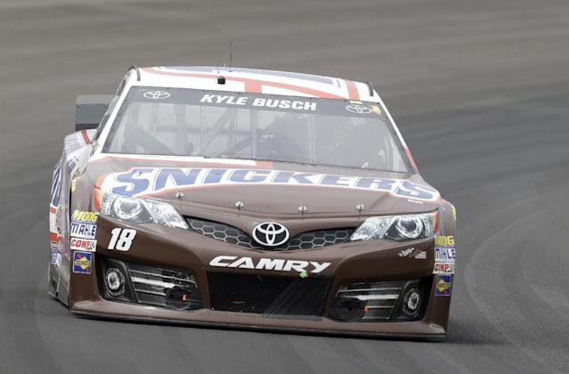Kyle Busch drives through Turn 1 during the Brickyard 400 auto race at Indianapolis Motor Speedway in Indianapolis, Sunday, July 27, 2014. (AP Photo/Tom Strattman)