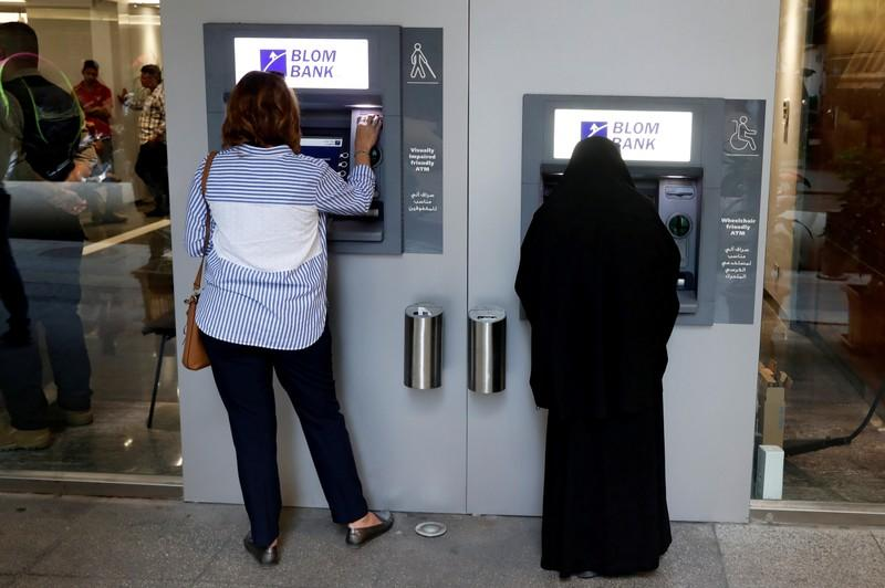 FILE PHOTO: Women use ATMs at Blom bank in Beirut