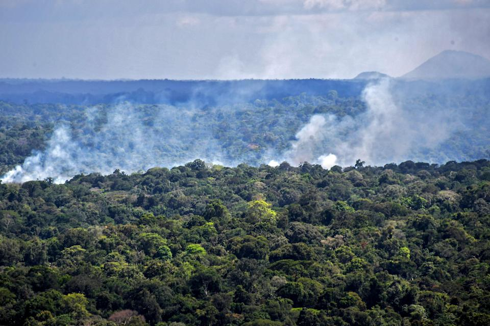 Aerial view showing smoke from a fire billowing from the Amazon rainforest in Oiapoque, Amapa state, Brazil (AFP via Getty Images)
