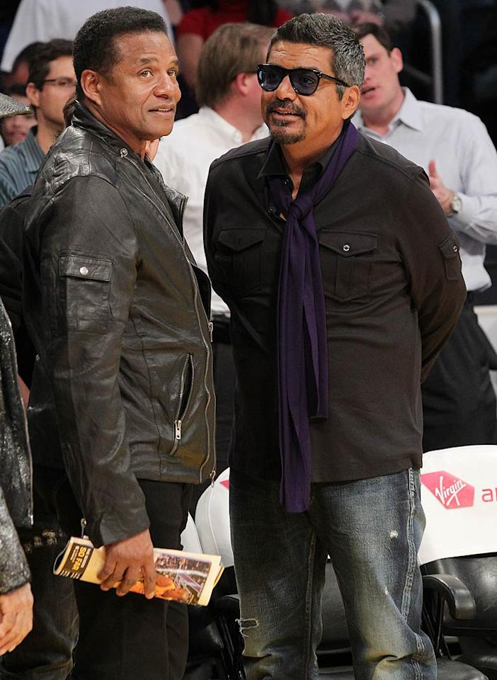 "Staples Center staple, George Lopez, chatted up the late King of Pop's brother Jackie while sporting a purple scarf. Let's go Lakers! Noel Vasquez/<a href=""http://www.gettyimages.com/"" target=""new"">GettyImages.com</a> - January 25, 2011"