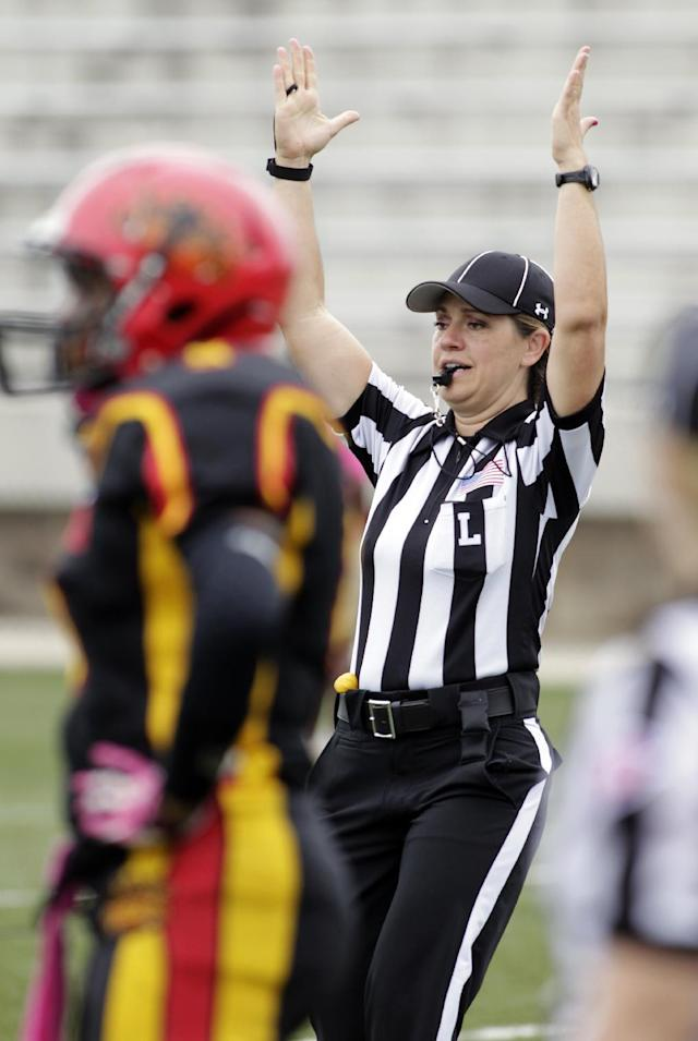 IMAGE DISTRIBUTED FOR NATIONAL FOOTBALL LEAGUE - Line Judge Catherine Conti signals a touchdown at the Legacy Bowl Women's Football Championship, on Friday July 25, 2014 at District Three Stadium in Rock Hill, S.C. The Carolina Queens beat the Minnesota Vixens 28-22. (Bob Leverone/AP Images for National Football League)