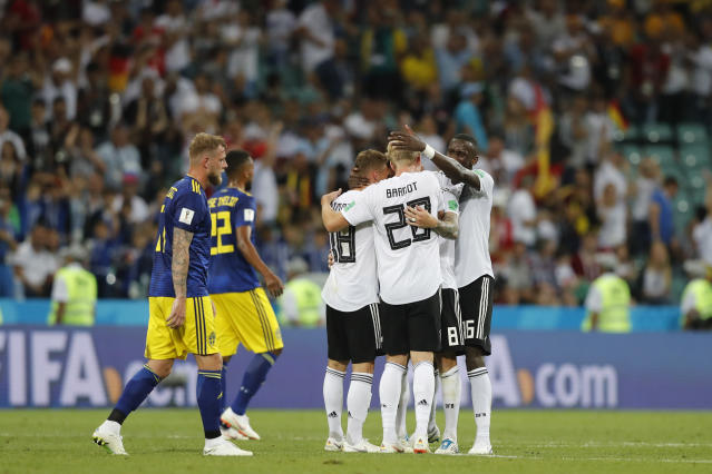 Germany players celebrate their team's 2-1 victory at the of the group F match between Germany and Sweden at the 2018 soccer World Cup in the Fisht Stadium in Sochi, Russia, Saturday, June 23, 2018. (AP Photo/Frank Augstein)
